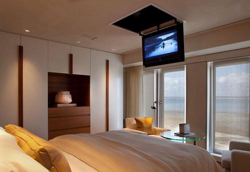 idea para colgar television en cuarto matrimonial